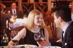 A couple dining in a restaurant; Size=240 pixels wide